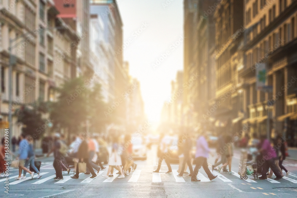 Fototapety, obrazy: Anonymous group of people walking across a pedestrian crosswalk on a New York City street with a glowing sunset light shining in the background