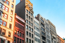 Row Of Tall Historic Buildings In The Afternoon Sunlight Along Broadway In Manhattan, New York City