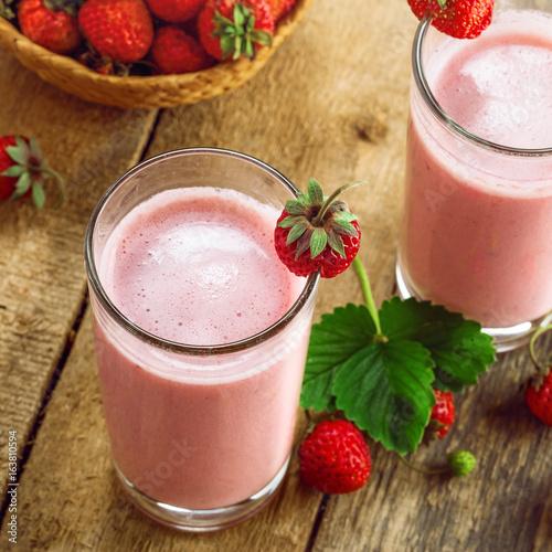 Foto op Plexiglas Milkshake Delicious fruit milkshake made of fresh ripe strawberry and milk. Diet drink for healthy breakfast. Top view.