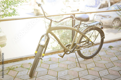 Fotobehang Fiets Vintage khaki bike in the old town