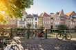 canvas print picture - Riverside view with beautiful old buildings and bicycles during the morning light in Gent city, Belgium