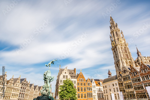 Foto op Plexiglas Antwerpen View on the beautiful buildings with fountain sculpture and church tower in the center of Antwerpen city in Belgium