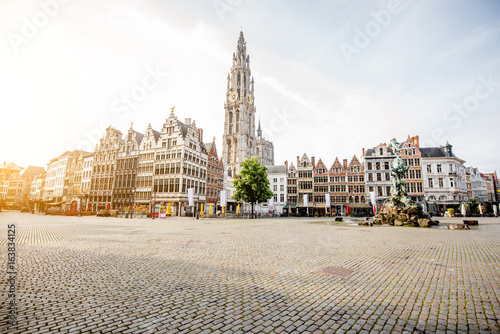 Photo Stands Antwerp Morning view on the Grote Markt with beautiful buildings and church tower in Antwerpen city, Belgium
