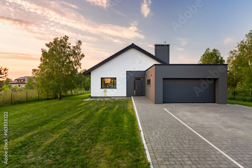 Fototapeta House with backyard and garage