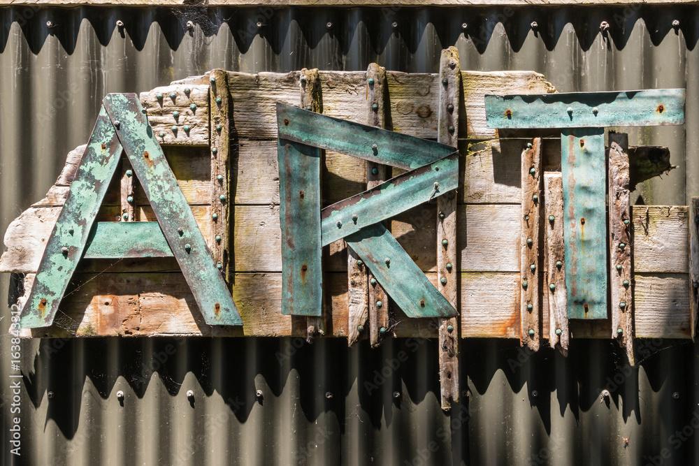 Photo  letters ART on corrugated iron fence