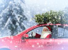 Santa Claus Delivering Christmas Tree By Car During Snowfall