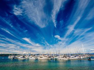 Fototapeta na wymiar Yachts moored at the marina, sunny day