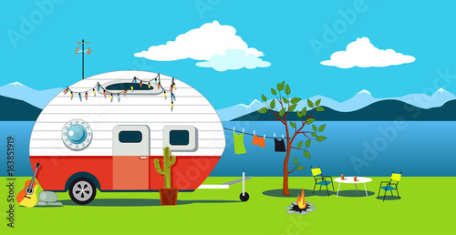 Fototapeta Cartoon travelling scene with a vintage camper, a fire pit, camping table and la