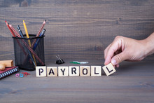 Payroll Concept. Wooden Letter...