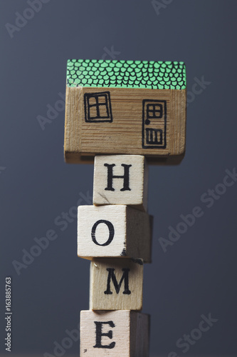 House model with home word made from wooden blocks  - Buy this stock