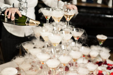 Many Glasses On A Table With Alcohol And Without