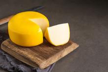 Round Gouda Cheese. Dark Background.