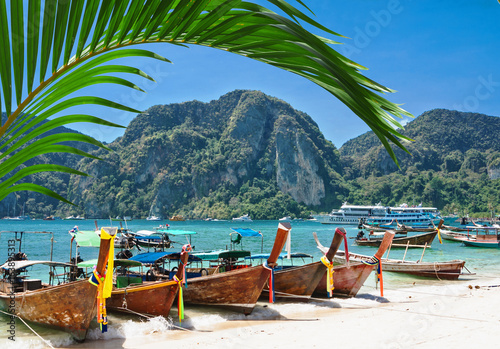 Fotografie, Obraz  Traditional Thai Longtail boat on the beach of Phi Phi Don