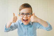 A Child With Glasses Gives A T...