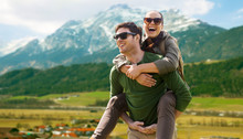 Happy Couple With Backpacks Traveling In Highlands