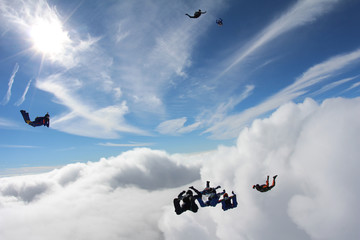 Obraz na płótnie Canvas Skydivers in the sky