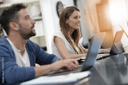 Fototapeta Trendy young people working in co-working office obraz na płótnie