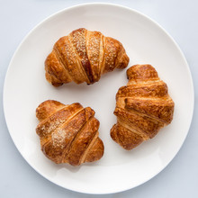 Croissants In A Plate On A Whi...