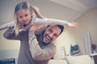 canvas print picture - Young dad with cute daughter at home.