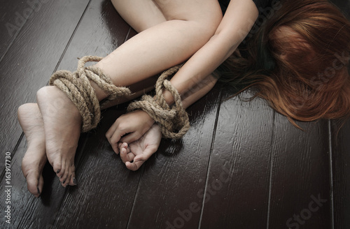 woman was tormented the hands and feet tied with a rope, stop violence concept Fototapeta