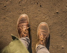 Dusty Deserted Army Boots On The Ground At Sunset