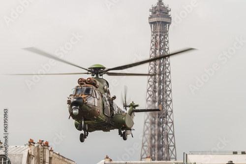 Helicopter In Front Of The Eiffel Tower For The Bastille Day In Paris    Hélicoptère Devant