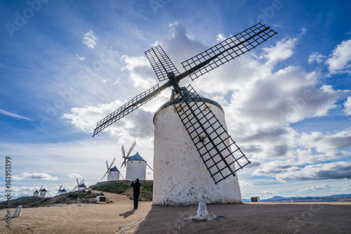 The windmill against the cloudy sky Plakat
