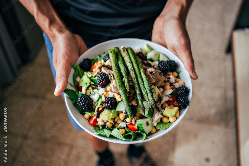 Fototapety, obrazy: Man hands holding big deep plate full of healthy paleo vegetarian salad made from fresh organic biological ingridients, vegetables and fruits, berries and other nutritional things