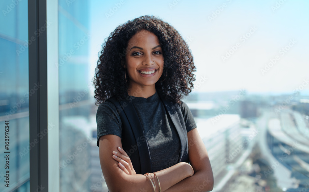 Fototapety, obrazy: Portrait of a smiling young businesswoman.