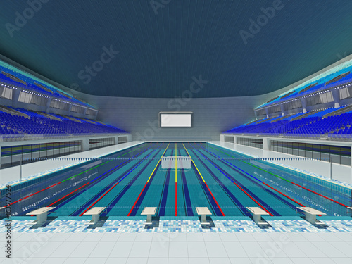 Indoor Olympic swimming pool arena with blue seats Buy this stock