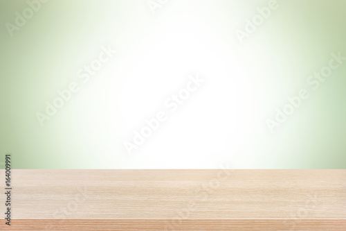 Poster Wall Wood table top on light green background