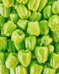 Fototapeta na wymiar organic green bell peppers top view, natural background