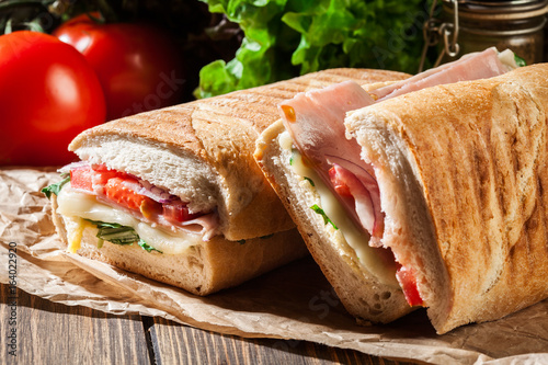Foto op Canvas Snack Toasted panini with ham, cheese and arugula sandwich