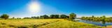 Fototapeta Natura - Landschaft im Sommer mit Bäumen, Wiesen, Fluss und Sonne