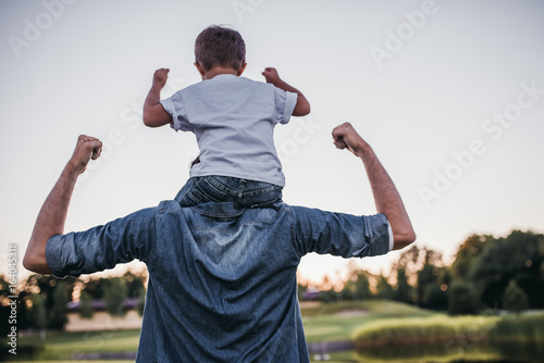 Fotografiet  Dad and son outdoors
