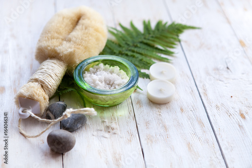 Spa Setting with Washcloth,Natural Soap and Sea Salt with Fern on white wooden b Poster