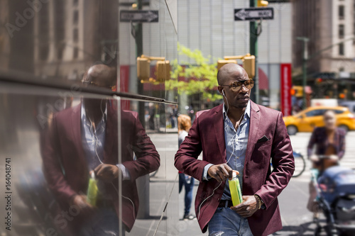 Stylish businessman using mobile phone. Manhattan. New York City.