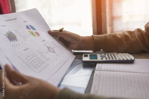 Fototapeta Businessman or accountant or banker making calculations and re check financial reports are set of documents prepared by an administrative team at the end of an accounting period. Concept finance obraz