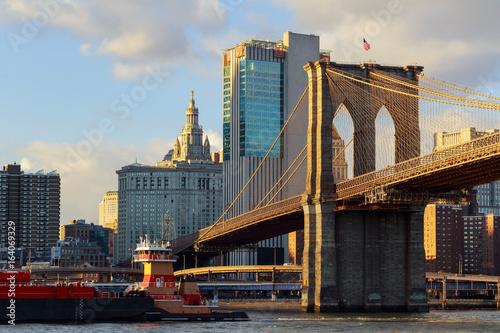 Poster Brooklyn Bridge The Brooklyn Bridge stands against blue sky downtown Manhattan skyscrapers