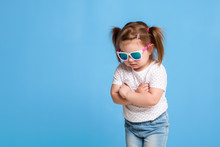 Fashion Portrait Of Girl Child On A Blue Background
