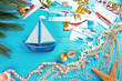 Summer vacation concept. Beautiful composition with boat and post cards on color wooden background