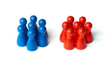 Game figures as a symbol for two groups of people. Concept for teamwork or challange. Isolated on white background.