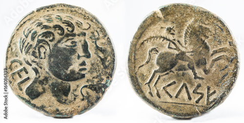 Foto  Ancient Iberian bronze coin minted in Celsa. As.