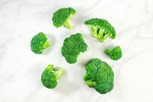 Three Vibrant Green Broccoli Florets With Copyspace