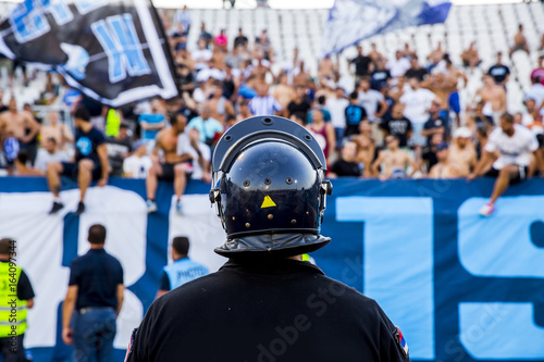Vászonkép  policeman with helmet guarding a sport event