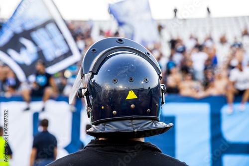 Fényképezés  policeman with helmet guarding a sport event