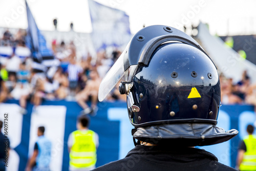 Valokuva  policeman with helmet guarding a sport event