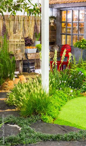 Fototapeta Stone pathway in garden./ Stone walkway in cozy garden with flower and plant.  obraz na płótnie
