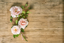 Bouquet Of Pink Roses On A Wooden Table, Top View With Copy Space