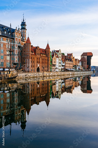 fototapeta na lodówkę Embankment of Motlawa river with reflection on water, Gdansk